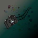 Камера, fil крена камеры, круги на темной предпосылке Стоковые Фотографии RF