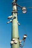 Камеры собирают на предпосылку голубого неба Стоковые Изображения RF