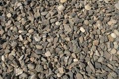 Камешки текстуры камешка небольшие гравий, строительный материал или погань стоковое фото