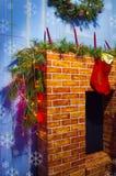 Камин рождества с орнаментами Стоковое Изображение