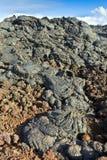 Камни вулканической подачи дают красивую структуру Стоковое Фото