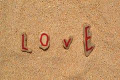 Камни в песке - влюбленности Стоковые Изображения RF