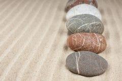 Камни в песке стоковые фотографии rf