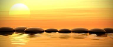 Камни Дзэн в воде на заходе солнца Стоковые Фотографии RF