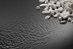 Камни и пульсации на черноте стоковые изображения rf