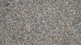 Камни на земле, предпосылке и текстуре формируют с скалистой поверхностью на верхней части Гравий в лете на месте Стоковое Изображение RF