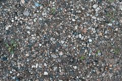 Камни на земле, предпосылке и текстуре формируют с скалистой поверхностью на верхней части Гравий в лете на месте Отброс на Стоковые Фото