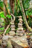Камни на зеленой предпосылке Стоковое фото RF