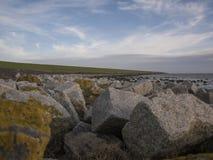 Камни на dike Waddensea Стоковая Фотография RF