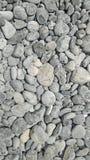 Камни предпосылка моря круглые лоснистые, взгляд сверху Стоковые Изображения