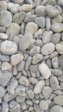 Камни предпосылка моря круглые лоснистые, взгляд сверху Стоковое Изображение RF