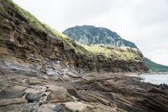 Камни с образованием лавы на Yongmeori приставают к берегу, Sanbang-ro, остров Jeju, Южная Корея Стоковая Фотография RF