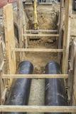 Канава экскаватора выкапывая на земной тубопровод 2 Стоковое Изображение