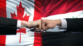Канада против конфликта Сирии, международных отношений, кулаков на предпосылке флага сток-видео
