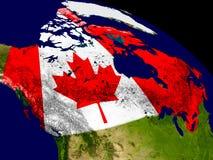 Канада с флагом на земле Стоковая Фотография
