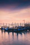 Канал и гондолы на заходе солнца в Венеции Стоковые Фотографии RF