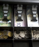 Канадские деньги в ящике Стоковая Фотография