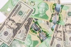 Канадский доллар на равенстве с долларом США Стоковая Фотография