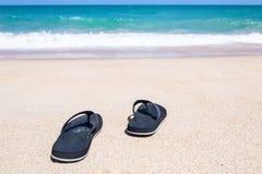 каникула перемещения тапочки принципиальной схемы пляжа стоковая фотография rf