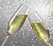 Каннелюры Шампани на серебряной светлой предпосылке bokeh Стоковые Фото