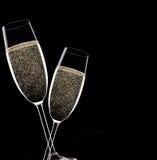Каннелюры Шампани на черной предпосылке Стоковые Фотографии RF