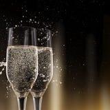 Каннелюры Шампани на черной предпосылке Стоковая Фотография