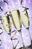 Каннелюры шампанского и ленты на праздниках Стоковое Фото