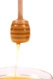 Капание меда от деревянной ручки Стоковая Фотография RF