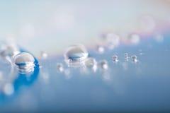 Капельки воды на компактном диске Стоковые Изображения