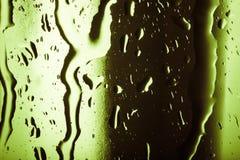 Капельки воды на покрашенных кубах льда абстрактным текстура графиков предпосылки произведенная компьютером Стоковое Фото