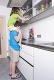 Капризные дети принимая помадки стоковое фото rf