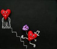 Капризные сердца на доске для меню Стоковые Изображения