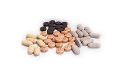Капсулы витамина, пилюльки и конец-вверх таблеток Стоковое фото RF