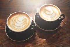 капучино придает форму чашки 2 Стоковые Изображения