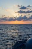 Карамболь военно-морского флота на заходе солнца Стоковые Фотографии RF
