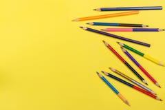 Карандаши цвета на желтом цвете стоковое изображение rf