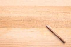 Карандаш на деревянной предпосылке Стоковые Изображения RF