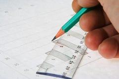 карандаш человека руки диаграммы пишет Стоковое Изображение