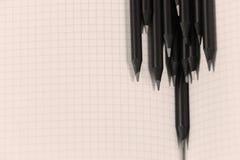 Карандаши на странице математики Стоковые Фотографии RF