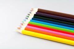 Карандаши цвета на сером цвете Стоковая Фотография