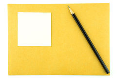 Карандаш и блокнот на конверте Стоковые Изображения RF