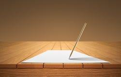 Карандаш и лист бумаги на деревянном столе стоковое фото rf