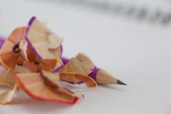 Карандаш с shavings карандаша на книге Стоковое Фото