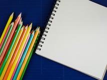 Карандаш цвета и тетрадь 13 Стоковое Фото
