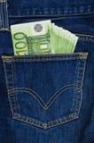 Карманн голубых джинсов с счетами евро Стоковое фото RF