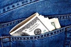 карманн джинсыов долларов кредиток Стоковые Изображения RF