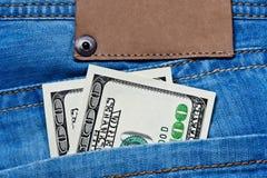 карманн джинсыов долларов кредиток Стоковая Фотография RF