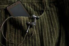 карманн игрока телефона mp3 джинсыов передвижное Стоковое Фото