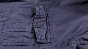 Карманн синего пиджака и плечо, конец вверх, кулачок сток-видео