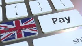 Карта банка отличая флагом Великобритании как ключ на клавиатуре компьютера Великобританский онлайн-платеж схематический иллюстрация штока